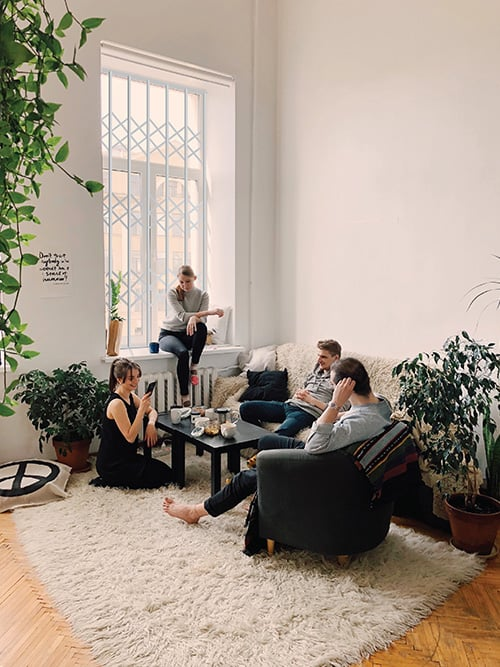 family sitting infront of window with security bars